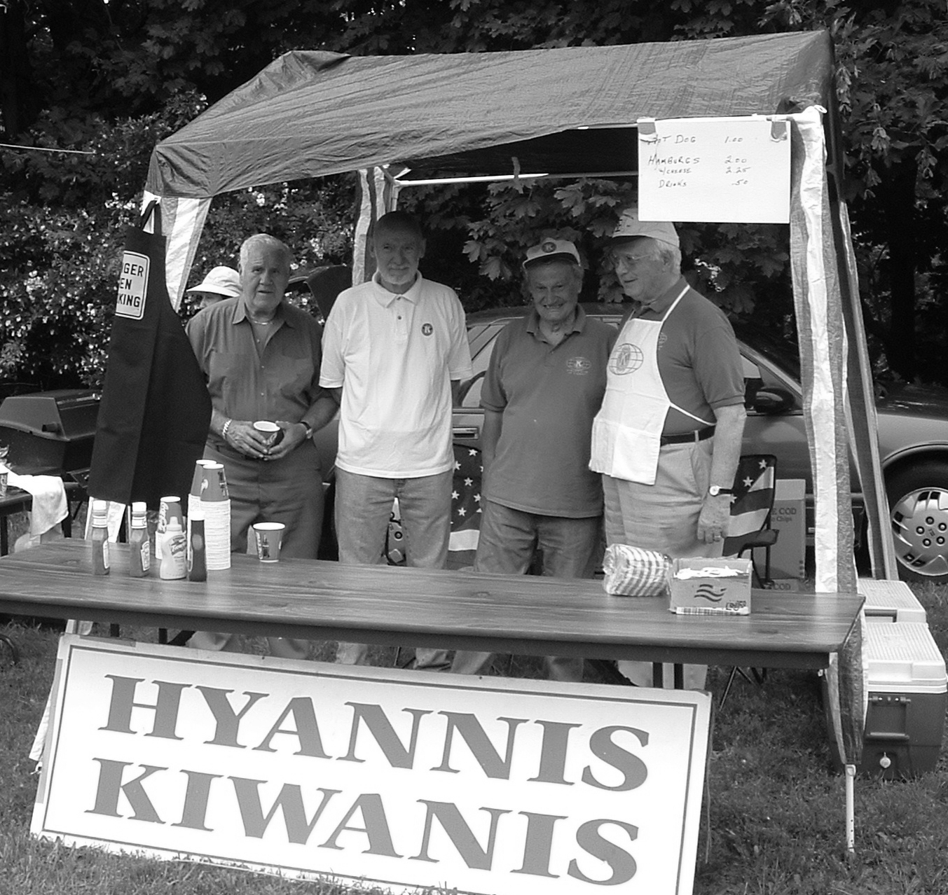 Bill Finkel, Jim Salts, Ray DuBois and Gene Burman at our booth at the July 4th Barnstable Village Annual Picnic in 2006